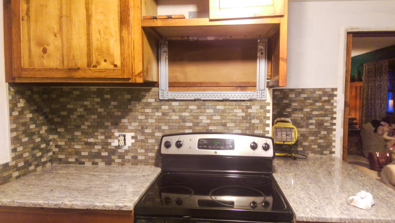 Tile on stove side 80% done