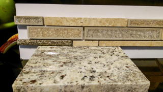Counter w long thin tile backsplash