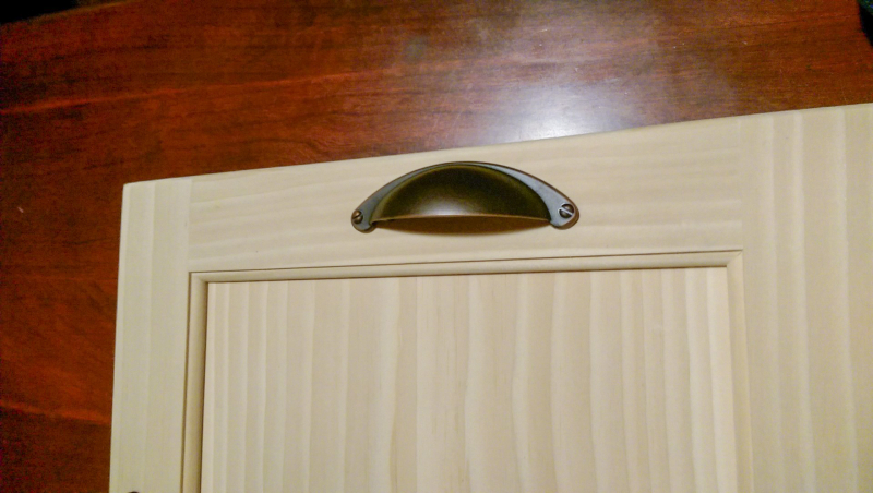 Cabinet door with cup pull