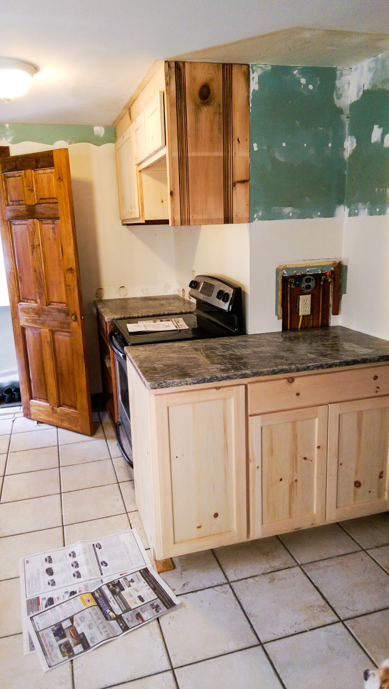 Counters and cabinets on stove side